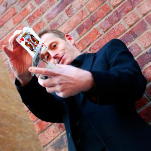 Close Up Magician - To enquire about this act please quote act code brsi